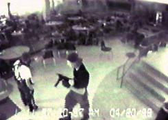 Video from the Columbine High School surveillance camera shows Eric Harris, left, and Dylan Klebold, carrying a TEC-9 semi-automatic pistol in the cafeteria. They later killed themselves in the library.