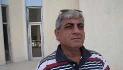 Falah Hadi, 49, started teaching at the University of Baghdad in July btu has yet to receive a paycheck.