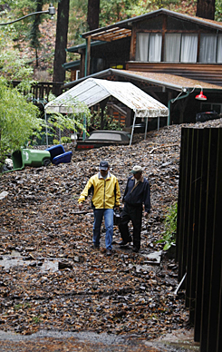 A mudslide covers a property Wednesday in Corralitos, Calif., after a rainstorm hit the  area. An evacuation order was in effect for residents of about 40 homes because of mudslides.
