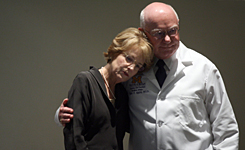 Mary Sue Coleman, University of Michigan president, and  Dr. Robert P. Kelch, executive vice president for medical affairs, console each other after speaking to reporters about the crash of a small plane that was carrying a six-member University of Michigan organ transplant team on June 5, 2007, in Ann Arbor, Mich.