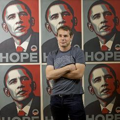 "Los Angeles street artist Shepard Fairey poses in January for a picture with his ""Hope"" artwork used to promote the Obama campaign."