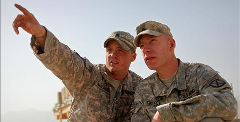 Army Sgt. Dustin Waggoner, left, and Sgt. 1st Class Gregory Frikken work on the rifle range in Forward Operating Base Airborne in Afghanistan. Frikken says his tours have changed him for the better.