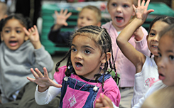 Analiesse Collins, 3, center, learns to count at a Worcester, Mass., child care center where most of the kids benefit from state subsidies.