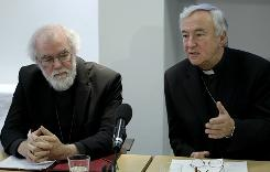 Britain's Archbishop of Canterbury Rowan Williams, left, from the Anglican church listens as Archbishop of Westminster Vincent Nichols from the Roman Catholic Church speaks during a news conference in London, held in reaction on Tuesday to the announcement of a new church structure for Anglicans who want to join the Catholic Church.