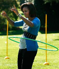 First lady Michelle Obama hula hoops on the South Lawn of the White House during an event promoting exercise and healthy eating for children on Wednesday in Washington, D.C.