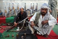 "More than 40 Afghan insurgents handed in their weapons last week in Herat province. ""Many people are sick of the fighting by now and are ready to compromise,"" Lt. Col. Tadd Sholtis said."