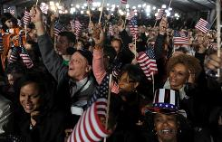 Supporters in Chicago's Grant Park cheer as Democratic presidential candidate Barack Obama is announced the winner over Republican John McCain on election night 2008.