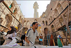 An Egyptian antiquities worker performs restoration work on the Ben Maimon Synagogue in Cairo, Egypt, August 20. The modern-day Egyptian view of the relics ranges from disinterest to outright hostility.
