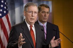 Senate Minority Leader Mitch McConnell, left, and House Minority Leader John Boehner appear at a news conference on Oct. 15. McConnell says Republicans still oppose the public option for health care.