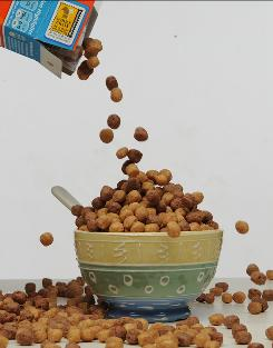 Spoonfuls of sugar: Cereals such as Reese's Puffs are aimed at kids.