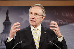 Senate Majority Leader Harry Reid speaks about health insurance on Capitol Hill on Monday.