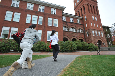 Students head to class on the campus of Cushing Academy in Ashburnham, Mass., where rows of books in the library have given way to study cubicles, lounge furniture and a cafe.