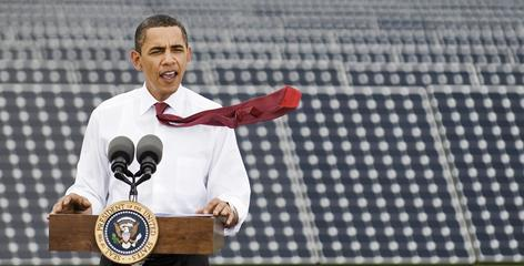 A gust of wind blows President Obama's tie as he speaks Tuesday during his visit to Florida Power & Light's Desoto Next Generation Solar Energy Center in Arcadia, Fla.