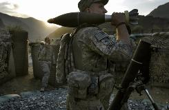 U.S. soldiers from the Army's 4th Infantry Division prepare to fire mortars Monday in the Pech Valley of Afghanistan's Kunar province.