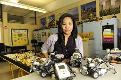 Ingrid Cruz teaches robotics at Scotlandville Middle Pre-Engineering Academy in Baton Rouge, La. The American Federation of Teachers union filed a complaint alleging U.S. recruiting firms held the visas of hundreds of Filipino teachers to get them to pay inflated fees, commissions and rents.