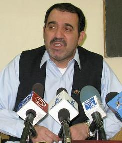 Ahmad Wali Karzai, the brother of Afghan President Hamid Karzai, speaks at a news conference in Kandahar in 2008.