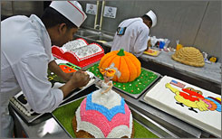 KBR employees prepare cakes for a Thanksgiving Day celebration in Baghdad in 2006.