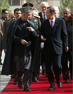 Afghan President Hamid Karzai, left, talks with U.N. Secretary-General Ban Ki Moon at the presidential palace in Kabul on Monday.