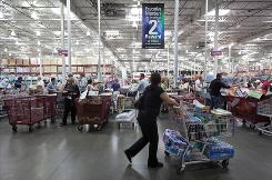 People shop at the Costco Wholesale store in Burbank, Calif. Costco said Oct. 28 it will start accepting food stamps nationwide after testing them in New York.