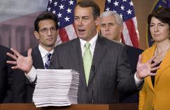 House Minority Leader John Boehner of Ohio, second from left, speaks behind a copy of the Democrat's version of the health care bill during a news conference on Capitol Hill Thursday in Washington. From left are, House Minority Whip Eric Cantor of Va., Boehner, Rep, Mike Pence, R-Ind., and Rep. Cathy McMorris Rodgers, R-Wash.