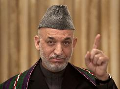 Afghan President Hamid Karzai speaks during a news conference Tuesday in Kabul. Karzai vowed to form an inclusive government and promised changes to root out corruption.