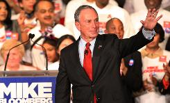 New York City Mayor Michael Bloomberg celebrates on stage after a narrow win over Democratic challenger William Thompson Tuesday in New York City.
