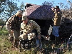 Amputee Brett Wolf is helped by Julie Mogenis after hunting at the Record Buck Ranch in Utopia, Texas. Mogenis, host of Huntin' with the Judge, taped the Iraq veteran's excursion for her show.