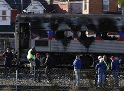  A Philadelphia commuter train caught fire Wednesday, complicating the morning rush already hampered by the city's transit strike. Officials said no injuries were reported. 