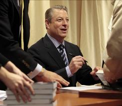 "Al Gore signs copies of his new book, ""Our Choice: A Plan to Solve the Climate Crisis,"" in New York City on Wednesday."