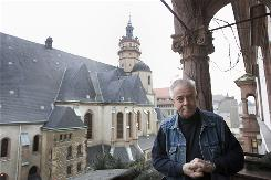 "Pastor Christian Fuehrer poses next to Leipzig's protestant Nikolai Church. Fuehrer was a leading figure in the ""Monday demonstrations"" which helped bring down East Germany's Communist regime."