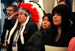 Richard Marcellais, tribal chairman of the Turtle Mountain Band of Chippewa Indians, salutes during the presentation of colors Thursday at the White House Tribal Nations Conference at the Department of Interior in Washington.