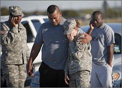 Sgt. Fanuaee Vea embraces Pvt. Savannah Green outside Fort Hood on Thursday.