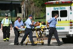 Emergency workers transport a victim from a shooting in downtown Orlando on Friday.