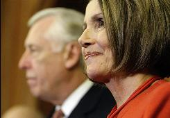 Speaker Nancy Pelosi smiles at a press conference after the House passed the health care overhaul bill on Saturday.