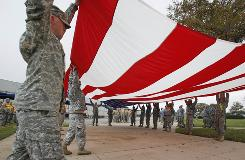 Soldiers from Fort Hood fold a flag Monday in preparation for President Obama's planned visit on Tuesday.