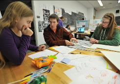 At Franklin Olin College: Students Sasha Sproch, left, Eric Jones and Margaret-Ann Seger design a swimming toy.