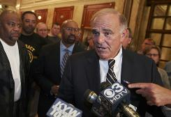 Gov. Ed Rendell answers questions as Mayor Michael Nutter, back center, and union president Willie Brown, far left, listen during a news conference announcing that the Southeastern Pennsylvania Transportation Authority had reached an agreement with its largest labor union on new contract provisions to end the strike.