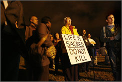 Virginia Rovnyak stands in protest outside Greenville Correctional Center in Jarratt, Va., just before the scheduled time of D.C. sniper John Muhammad's execution.