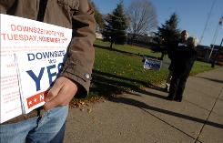 "Kevin Gaughan, founder of the ""political downsizing"" movement in western New York, chats with voters on Election Day."