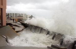 Waves from Tropical Storm Ida wreak havoc on Jerry East Condominiums on Tuesday in Destin, Fla.