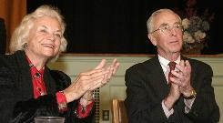 In this 2004 photo, Supreme Court Justice Sandra Day O'Connor and her husband, John, attend an awards ceremony in Huntington, N.Y.
