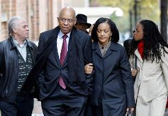 Former Rep. William Jefferson, D-La., and his wife, Dr. Andrea Green Jefferson, arrive for his sentencing at the U.S. District Court in Alexandria, Va., on Friday. Jefferson, who was caught with $90,000 in cash in his freezer, was convicted on multiple charges of bribery and money laundering.
