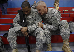 Lt. Col. Houck and Army Warrant Officer Carlton Royster, 30, of Philadelphia, pray together during a farewell event for the III Corps Special Troops Battalion on the verge of deploying to Iraq.