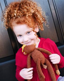 Meredith Ambrose, 6, of St. Louis, gets lots of attention for her red curly locks, according to her mother, Debbie.