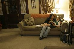 Jennifer Berndsen helps son T.J., 9, catch up on homework. T.J., who has asthma, ended up being hospitalized with complications from H1N1.