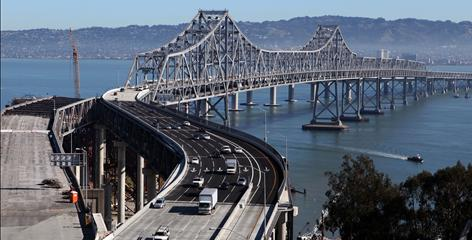 Traffic flows across the eastern span of the San Francisco-Oakland Bay Bridge in San Francisco, California. The bridge closed twice this fall due to construction glitches.