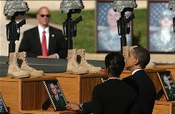 President Obama and first lady Michelle Obama pay their respects to Fort Hood shooting victims during the Nov. 10 memorial ceremony.