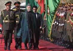 Afghan President Hamid Karzai inspects guard of honor during his inauguration at the Presidential Palace in Kabul.