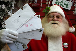 "Santa Claus, also known as Patrick Farmer, holds letters from children sent to ""Santa Claus, North Pole"" that will no longer be delivered after the postal service axed the program in North Pole, Ala."