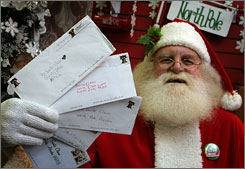 Santa Claus, also known as Patrick Farmer, at Santa Claus House in North Pole, Alaska, Wednesday, holds letters from children sent this year.